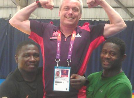 Being hoisted aloft by Nigerian wrestlers  Andrew Abido Dick and Sinivie Boltic